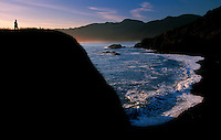 A woman looks out over Black Sand Beach, part of California's Lost Coast which includes King Range. The oldest conversation area, King Range faces one of the newest componenets of BLM's Clinton-era conservation initiatives, the offshore California Coastal National Monument. King Range and the Lost Coast is an unusual piece of land for BLM.  It is a remote  65.000 acres surrounded by private land where most BLM land surrounds private land. The land was homesteaded, and all that was left was undesirable being too steep and too rocky to live on. There are 35 miles of rocky coastline stretching from the Mattole River to the Sinkyone Wilderness Area.