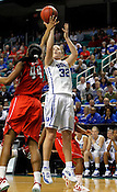 Tricia Liston makes a 3-pointer to add onto her 14 total points. NC State defeated Duke 75-73 during quarter finals of the 2012 ACC Women's Basketball Tournament at the Greensboro Coliseum in Greensboro, NC. Photo by Al Drago.