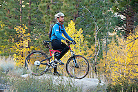Mountain biker admiring the view on Lower Rock Creek with fall color.