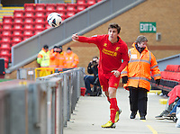 LIVERPOOL, ENGLAND - Easter Monday, April 1, 2013: Liverpool's Adam Morgan acts as a ball boy during the Under 21 FA Premier League match against Tottenham Hotspur at Anfield. (Pic by David Rawcliffe/Propaganda)