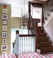 The change to chocolate brown in the colour scheme of the simple staircase landing emphasises the transition to the second floor