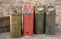 Old decrepit gas cans abandoned in the desert