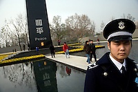 "A policeman stands guard near a peace sculpture in the grounds outside the Memorial Hall of the Nanjing Massacre in Nanjing, China, on Thursday, Dec. 13, 2007.  After two years of renovations, the Memorial Hall of the Nanjing Massacre reopened to the public on Dec. 13, 2007, the 70th anniversary of the 6-week massacre by Japanese troops that started Dec. 13, 1937 and claimed more than 300,000 lives.  The commemoration comes amid renewed controversy about the accuracy of historical accounts of the massacre.  The massacre is also known as ""The Rape of Nanking."""