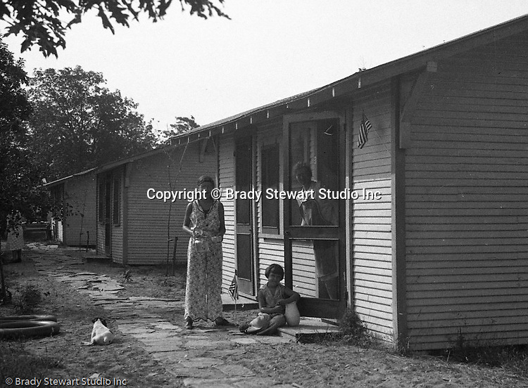 Family in front of a rental cabin the brady stewart for Lake cabin rentals pennsylvania
