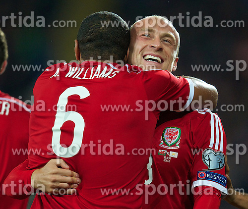 13.10.2014, City Stadium, Cardiff, WAL, UEFA Euro Qualifikation, Wales vs Zypern, Gruppe B, im Bild Wales' David Cotterill celebrates scoring the first goal against Cyprus with team-mate captain Ashley Williams // 15054000 during the UEFA EURO 2016 Qualifier group B match between Wales and Cyprus at the City Stadium in Cardiff, Wales on 2014/10/13. EXPA Pictures &copy; 2014, PhotoCredit: EXPA/ Propagandaphoto/ David Rawcliffe<br /> <br /> *****ATTENTION - OUT of ENG, GBR*****