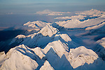 Aerial view over North Cascades National Park in winter.  Mount Baker in background.