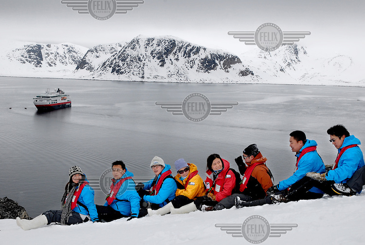 "photograph by XAVIER CERVERA 06/2010.Chinese tourists pose in spontaneous and choral compositions, but very ordered, in Ytre Norskøya Hills, northwestern Spitsbergen island, Svalbard archipielago; on the ""evening landing"" (usually two per day) from norwegian vessel (made in Italy) MS Fram"