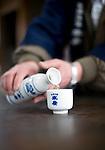 Photo shows Suehiro Sake Brewery in Aizu-wakamatsu City, Fukushima, Japan on 15 March 2013.  Photographer: Robert GilhoolyA staffer pours some sake at the Suehiro Sake Brewery in Aizu-wakamatsu City, Fukushima, Japan on 15 March 2013.  Photographer: Robert Gilhooly