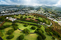 An aerial perspective of Punchbowl National Cemetery with Tantalus and Nu'uanu in the background, O'ahu.