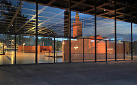 The Neue Nationalgalerie or New National Gallery at night, a modern art museum at the Kulturforum in West Berlin, Germany. The building and its sculpture gardens were designed by Ludwig Mies van der Rohe, 1886-1969, and opened in 1968. The St Matthaus-Kirche is reflected in its glass windows. Picture by Manuel Cohen