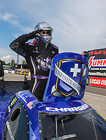 Sep 25, 2016; Madison, IL, USA; NHRA funny car driver Jack Beckman salutes as he celebrates after winning the Midwest Nationals at Gateway Motorsports Park. Mandatory Credit: Mark J. Rebilas-USA TODAY Sports