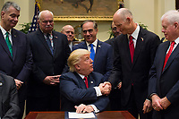 United States President Donald Trump shakes hands with Governor Rick Scott (Republican of Florida after signing S. 544 the Veterans Choice Program Extension and Improvement Act in the Roosevelt Room at the White House in Washington, DC on April 19,2017.<br /> CAP/MPI/CNP/RS<br /> &copy;RS/CNP/MPI/Capital Pictures