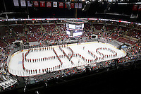 OSU band preforms Script Ohio after the first period at Value City Arena in Columbus Dec. 2, 2013.