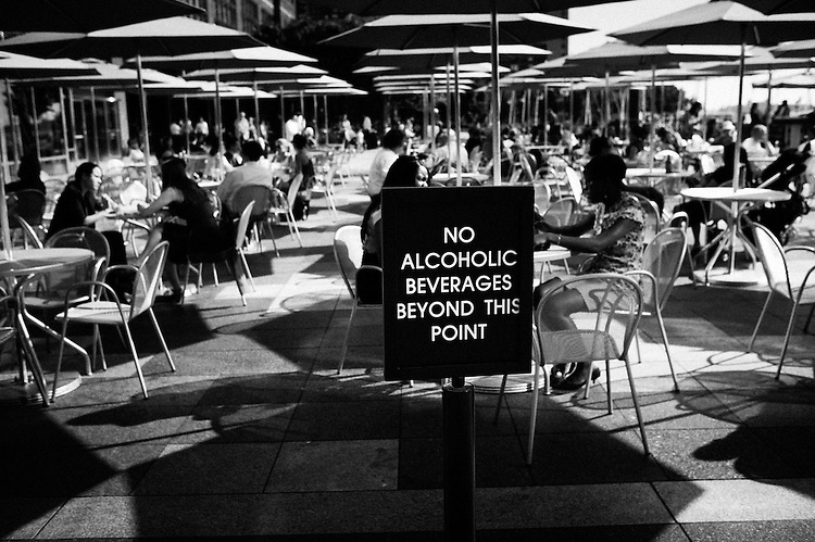 "NEW YORK, NY, USA. JUNE 15, 2010. Behind the financial center, in a bar. A sign reads: ""No alcoholic beverages beyond this point"".  Wandering around Ground Zero while listening to a text Paul Auster recorded for Soundwalk (www.soundwalk.com/#/TOURS/groundzero/). Photo: Antoine Doyen"