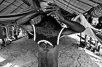 Gold mining, Amazon, Brazil. Prospectors rudimentary tent in the forest. Agua Branca region, Para State.