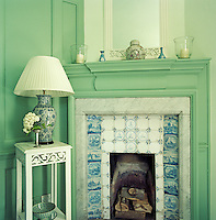 The Delft tiles which surround the fireplace in the Green Room were chosen by Henry James