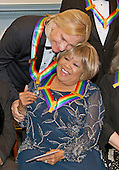 Joe Walsh of the rock band &quot;The Eagles,&quot; left, one of the five recipients of the 39th Annual Kennedy Center Honors, hugs gospel and blues singer Mavis Staples, right, as they prepare to pose for a group photo following a dinner hosted by United States Secretary of State John F. Kerry in their honor at the U.S. Department of State in Washington, D.C. on Saturday, December 3, 2016.  The 2016 honorees are: Argentine pianist Martha Argerich; rock band the Eagles; screen and stage actor Al Pacino; gospel and blues singer Mavis Staples; and musician James Taylor.<br /> Credit: Ron Sachs / Pool via CNP
