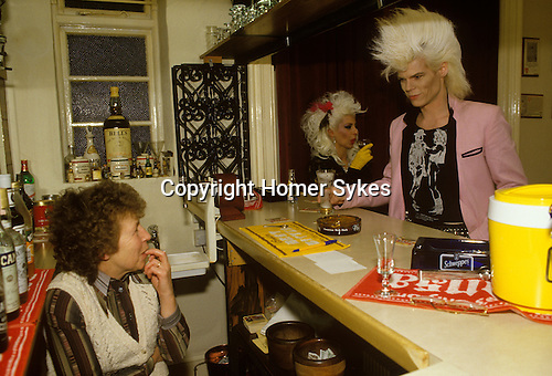 Bed and Breakfast Hotel landlady. Newcastle upon Tyne, UK. Sigue Sigue Sputnik, band members Neal Whitmore aka Neil X, and Jane Farrimond aka Yana Yaya. Neal is wearing a Tom of Finland Tshirt. New Romantics movement.