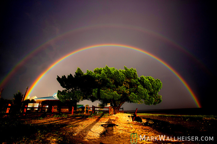 After several days of rain, the sky broke and brought out a full double rainbow before the rains returned at Shell Point Beach in Wakulla County, Florida.