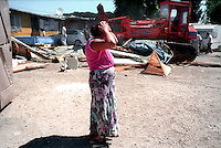 Roma 5 July 2007.Vacated Rom's camp  of via della Martora inhabited to Rudari Romani forced to leave the camp by the police..The house destroyed by the bulldozers of the municipality of Rome, woman is in despair