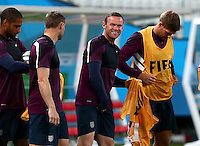 Wayne Rooney of England smiles during training ahead of tomorrow's Group D match vs Uruguay