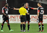 Chris Korb (22) of D.C. United argues with referee Hilario Grajeda after getting fouled and cut in his eye. Toronto FC defeated D.C. United 2-1, at RFK Stadium, Saturday June 15 , 2013.