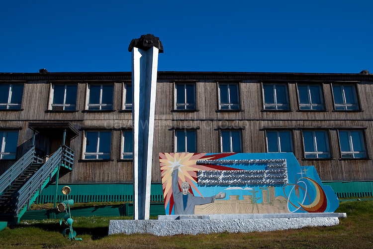 Mural and sculpture of coal miners at Barentsburg, a Russian coal mining town in the Norwegian Archipelego of Svalbard. Once home to about 2000 miners and their families, less than 500 people now live here.