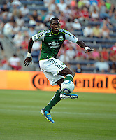 Portland midfielder James Marcelin (14) controls the ball in the air.  The Portland Timbers defeated the Chicago Fire 1-0 at Toyota Park in Bridgeview, IL on July 16, 2011.