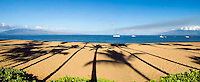 Morning on Ka'anapali Beach with palm tree shadows in the sand, Maui, Hawaii.