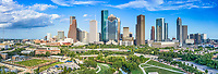 This is a aerial panorama of the Houston skyline view of the city which includes the Buffalo Bayou along with the Jamail Skate Park and the Eleanor Tinsley Park with all the high rise skyscrapers in downtown in view.