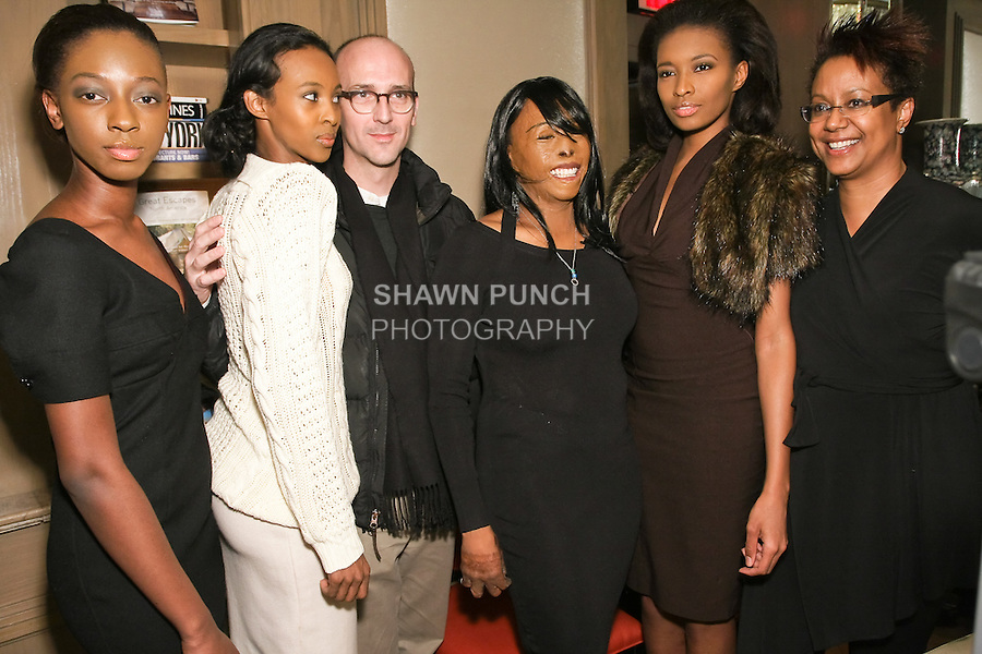 (L-R) Models, fashion designer R. Scott French, Linda Rowe Thomas, model, and guest pose backstage at the Romas by Linda Rowe Thomas Fall/Winter 2011 collection presentation, during New York Fashion Week.
