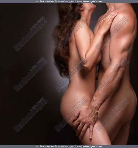 Nude couple a man and a woman isolated on black background