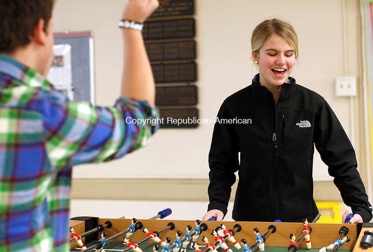 "Morris, CT- 17, January 2010-011711CM11 COUNTRY LIFE ONLY PELASE  Jake Finch, 14, of Morris and Addy Keilty, 13, of Morris play a game of Foosball with friends Monday afternoon at the 3rd annual ""Game Day"" at the Morris Town Hall.  Christopher Massa Republican-American"