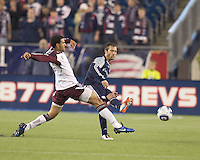 New England Revolution defender A.J. Soares (5) passes the ball as Colorado Rapids forward Andre Akpan (19) defends. In a Major League Soccer (MLS) match, the New England Revolution tied the Colorado Rapids, 0-0, at Gillette Stadium on May 7, 2011.