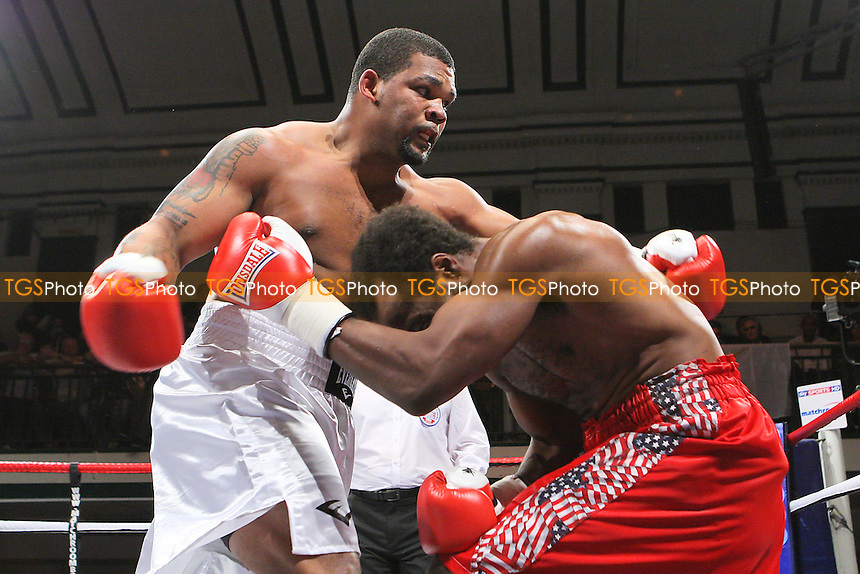 Mike Perez (white shorts) defeats Zack Page in a Heavyweight boxing contest at York Hall, Bethnal Green, promoted by Matchroom Sports - 09/11/11 - MANDATORY CREDIT: Gavin Ellis/TGSPHOTO - Self billing applies where appropriate - 0845 094 6026 - contact@tgsphoto.co.uk - NO UNPAID USE.