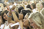 A sorority pledge holds an envelope above her head during the 2011 sorority bid day event in Memorial Coliseum on Thursday, August 18, 2011. Photo by Brandon Goodwin | Staff