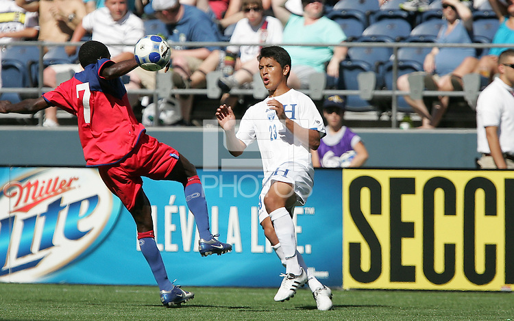 Brunel Jucien (7) and Roger Espinoza (23) battle for the ball. Honduras defeated Haiti 1-0 during the First Round of the 2009 CONCACAF Gold Cup at Qwest Field in Seattle, Washington on July 4, 2009.