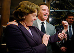 Governor Arnold Schwarzenegger feels the muscles of US Senator Diane Feinstein outside his office at the State Capitol, Thursday Feb. 21, 2008. Schwarzenegger was responding to the question if he needed her help to get a deal on the water bonds in California. The governor called a special session last year to hash out a deal to boost California's water supply, but lawmakers failed to broker a deal. The two sides are still divided about how to spend money on dams. (Sacramento Bee/MCT/ Brian Baer / BBAER@SACBEE.COM)..