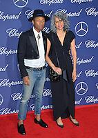Singer/producer Pharrell Williams &amp; producer Mimi Valdes at the 2017 Palm Springs Film Festival Awards Gala. January 2, 2017<br /> Picture: Paul Smith/Featureflash/SilverHub 0208 004 5359/ 07711 972644 Editors@silverhubmedia.com