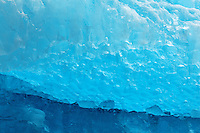 Closeup of blue glacial ice on iceberg floating in Tracy Arm, Southeast Alaska, USA