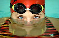 Close up of swimmer's face partially submerged in the swimming pool.