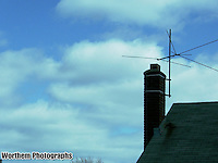 A new day dawns with an old television antenna on the chimney