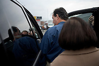 Former congressman Rick Santorum enters a pickup to move to the next campaign stop after speaking to the Queen City Rotary at the Puritan Backroom restaurant in Manchester, New Hampshire.  Santorum is a candidate for the GOP 2012 presidential nominee.