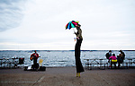 A stilt walker performing  on the Lake Mendota lakefront  near the University of Wisconsin campus in Madison, Wisconsin.