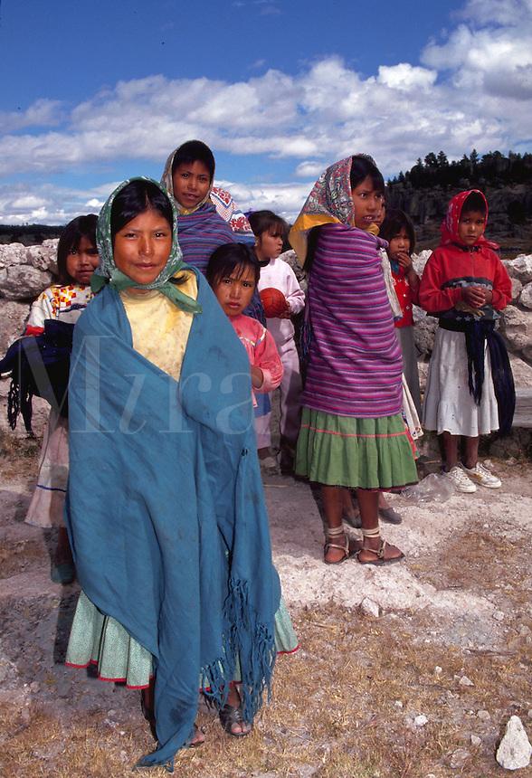 Tarahumara Indian children in colorful capes at San Ignacio Mission school. Copper Canyon, Mexico.