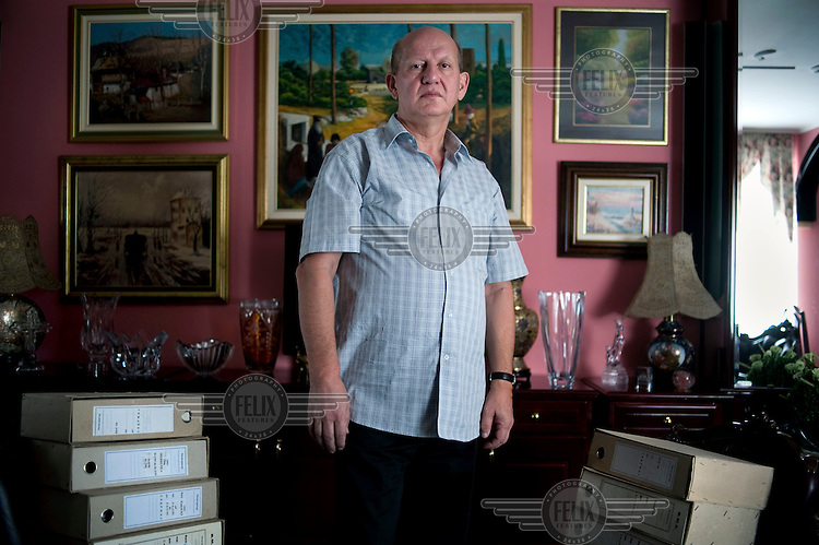 Zoran Stankovic, Chief of Pathology at the Military Academy in Belgrade surrounded by forensic files from the war in Bosnia where he worked as a pathologist. He is a close friend of Ratko Mladic and performed the autopsy on Mladic's daughter following her suicide. Stankovic also recently served as Minister of Defence in the Government of Serbia. Former Bosnian Serb general Ratko Mladic is one of the most sought after suspects from the Bosnian conflict. He has been indicted by the UN war crimes tribunal on charges of genocide and crimes against humanity.