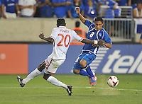 William Romero (8) of El Salvador goers against Seon Power (20) of Trinidad & Tobago.  Trinidad & Tobago tied El Salvador 1-1 in the first round of the Concacaf Gold Cup, at Red Bull Arena, Monday July 8 , 2013.