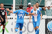 Philadelphia Union midfielder Brian Carroll (7) celebrates his score in the 8th minute of the game with teammate Danny Cruz (44) D.C. United tied The Philadelphia Union 1-1 at RFK Stadium, Saturday August 19, 2012.