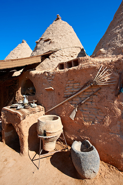 """Pictures of the beehive adobe buildings of Harran, south west Anatolia, Turkey.  Harran was a major ancient city in Upper Mesopotamia whose site is near the modern village of Altınbaşak, Turkey, 24 miles (44 kilometers) southeast of Şanlıurfa. The location is in a district of Şanlıurfa Province that is also named """"Harran"""". Harran is famous for its traditional 'beehive' adobe houses, constructed entirely without wood. The design of these makes them cool inside. 12"""