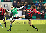 Hibs v St Johnstone....21.12.13    SPFL<br /> Murray Davidson and James Collins. Davidson went off injured a few minutes later<br /> Picture by Graeme Hart.<br /> Copyright Perthshire Picture Agency<br /> Tel: 01738 623350  Mobile: 07990 594431